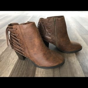 Woman's brown distressed ankle boots